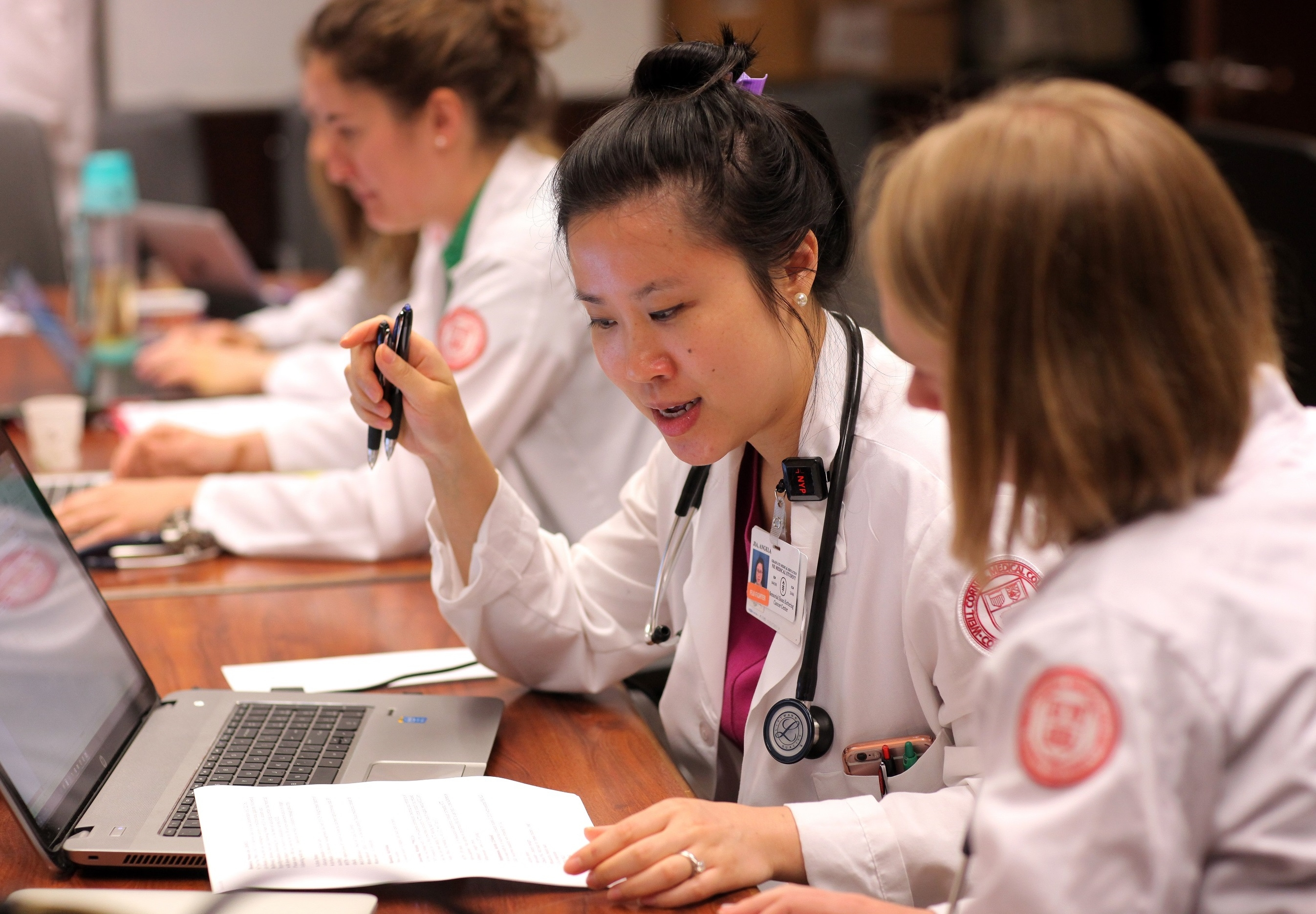 Female doctors studying. Credit: John Abbott