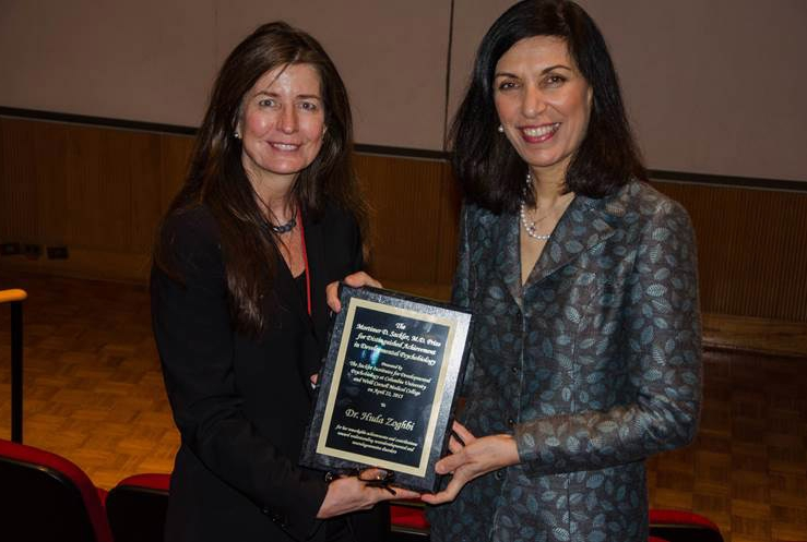 Dr. B.J. Casey presents Dr. Huda Zoghbi with a plaque for the Mortimer D. Sackler, M.D. Prize for Distinguished Achievement in Developmental Psychobiology Photo Credit: Meredith Wright