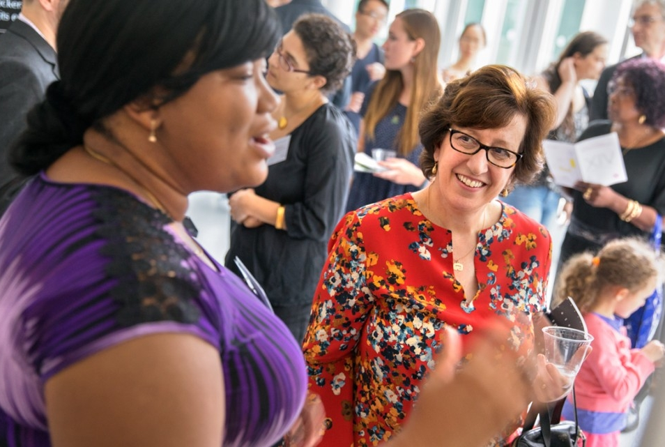 President Martha E. Pollack visits with a student presenter during the Festival of Scholarship, Aug. 24 in the Physical Sciences Building Atrium. The festival kicked off three days of events that include the Aug. 25 inauguration of Pollack as Cornell's 14th president.
