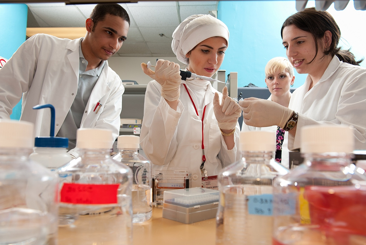 Fahad Al-Marri (left) and Faten Aqeel (center) conducting research.