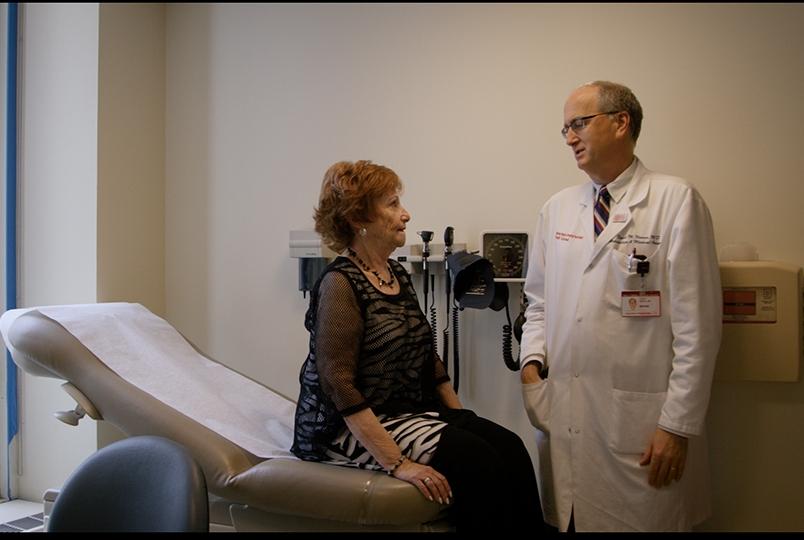 Dr. David Nanus speaks with his patient, Irene Price.