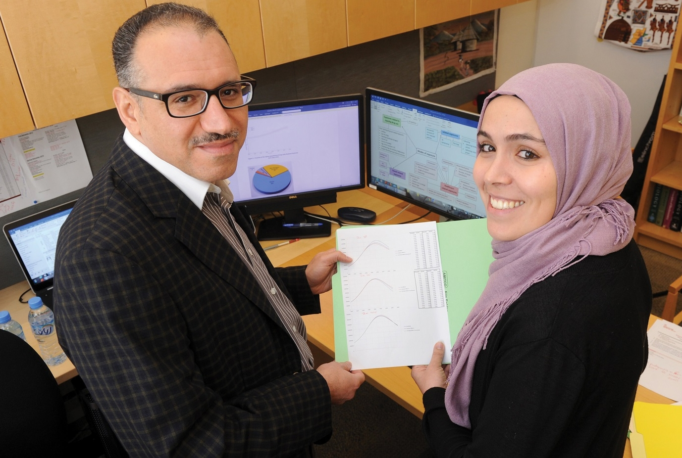Dr. Laith Abu-Raddad (left), and Susanne Awad. Photo credit: The Qatar Foundation