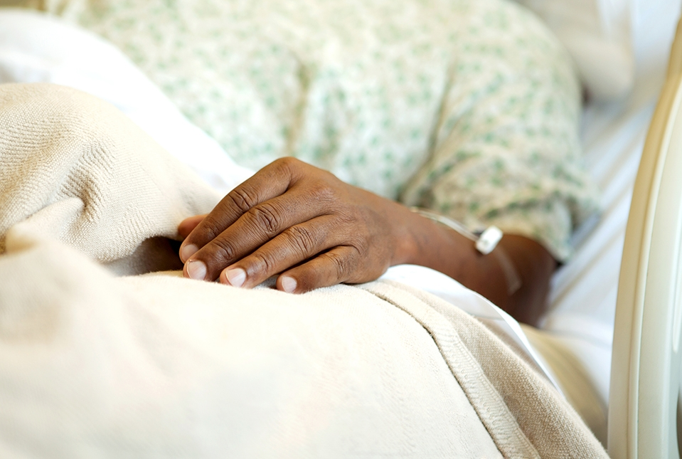 elderly Black person in hospital bed