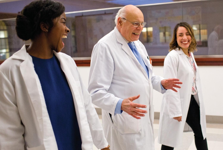 Dr. Thomas Caputo, MD (center), with Dr. Simone Elder MD'18 (left) and Dr. Sasha Hernandez MD'18, both alumni of the Glickman Fellowship program. Photo credit: John Abbott