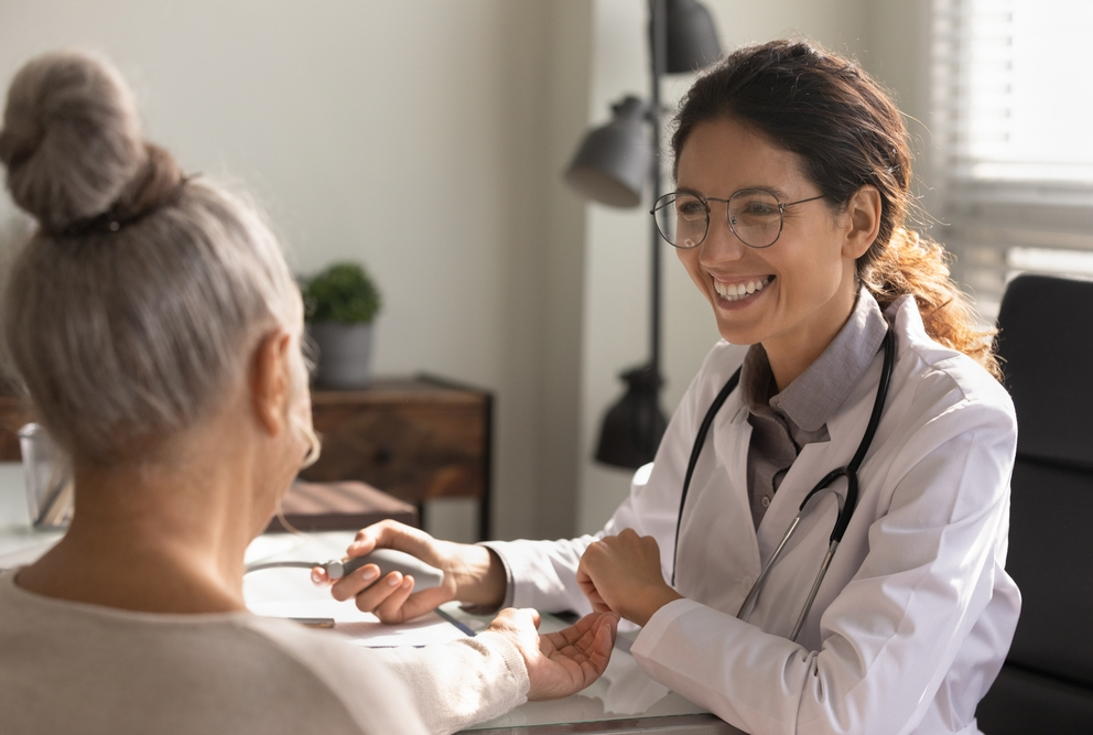 a woman of color getting a check up from a doctor