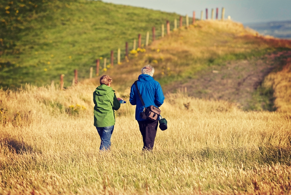 older man and woman taking a walk