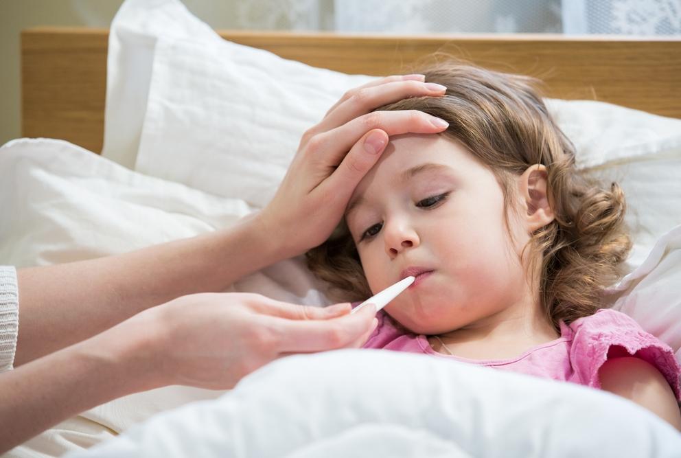 a child having their temperature taken
