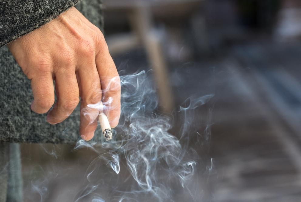 someone holding a cigarette