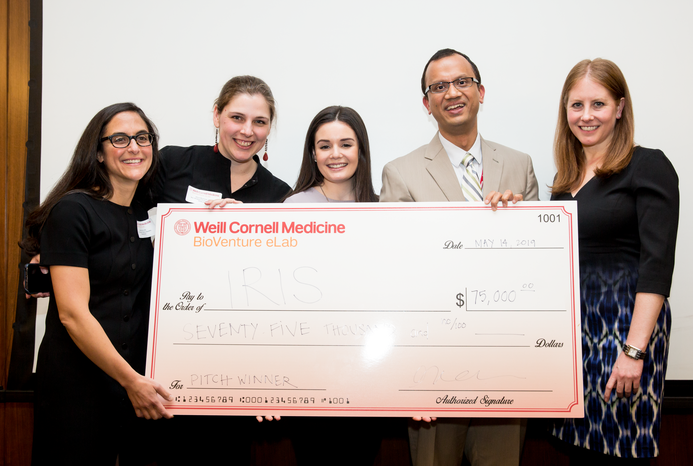 The company Iris takes first prize in the $100,000 Biomedical Business Plan Challenge. Team members from left to right: Drs. Rochelle Joly, Alison Herman, Meghan Reading Turchioe, Jyotishman Pathak, and graduate student Andrea Cohen. [Not pictured:Dr. Yiye Zhang]. All photos: Ashley Jones.