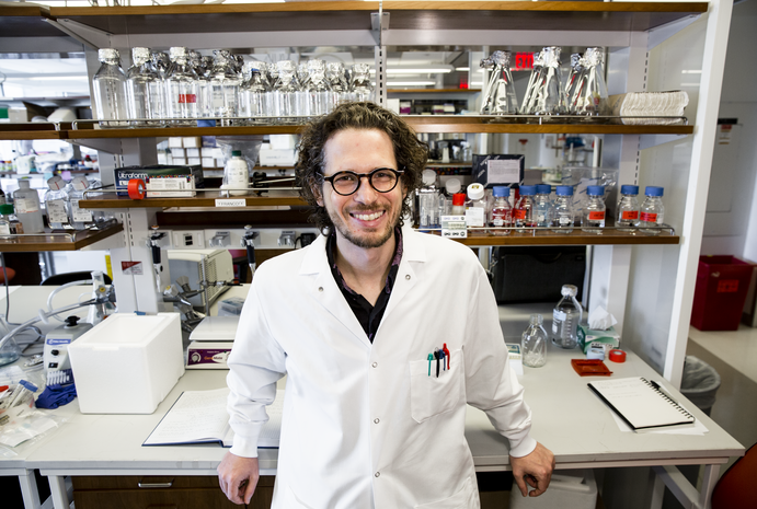 a man in a lab posing for a picture