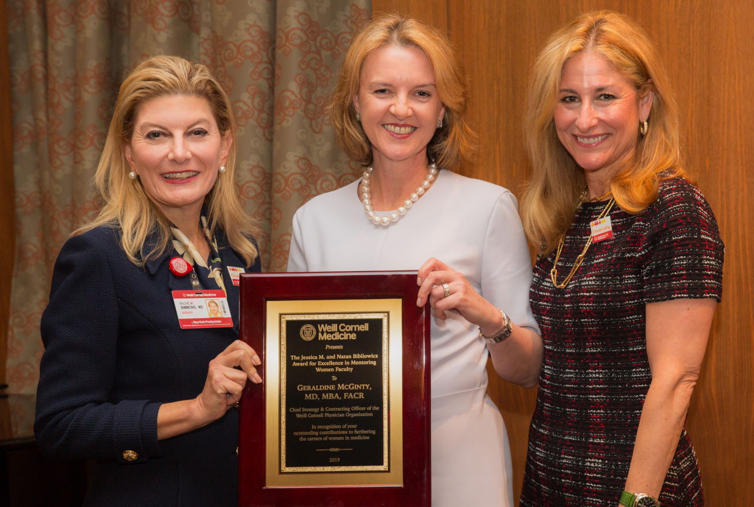 Dr. Geraldine McGinty accepts the 2019 Jessica M. and Natan Bibliowicz Award for Excellence in Mentoring Women Faculty from Jessica Bibliowicz and Dr. Rache Simmons. Credit: Ashley Jones