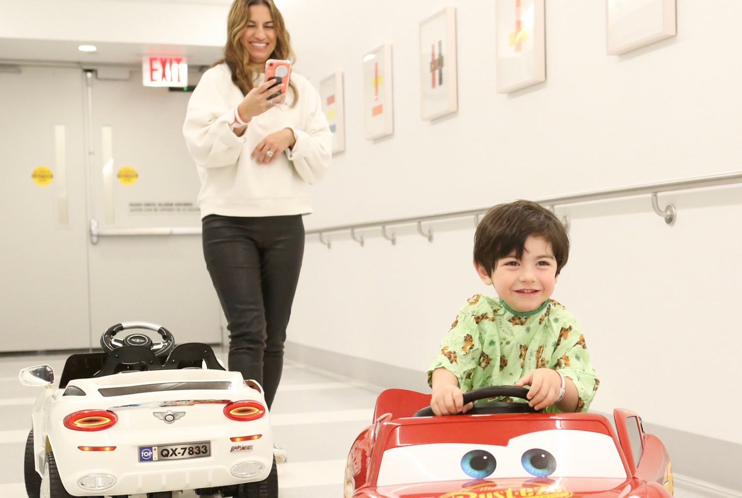Elena Silverman films her son Jamie riding in one of the miniature cars as he awaits surgery. Credit: Julia Xanthos Liddy