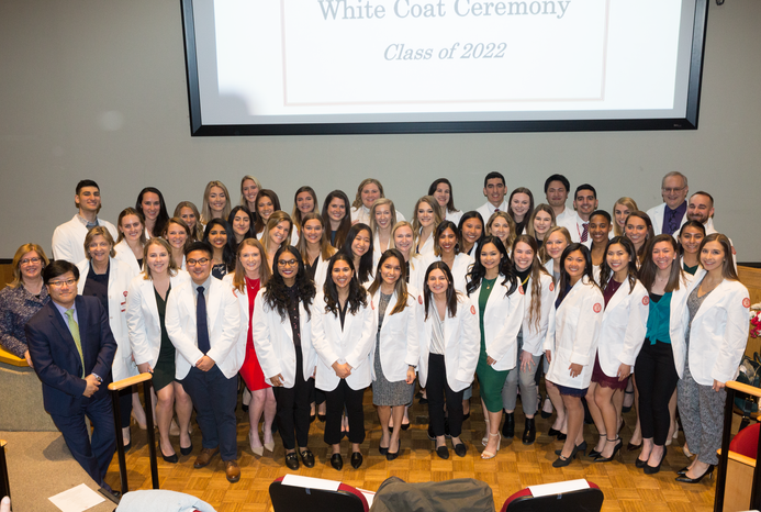 Students gathered together to take a photo at their white coat ceremony