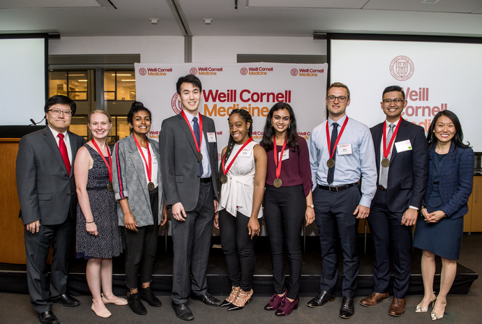 Students receive their Siegel Family Student Prizes April 29 during the Salute to Scholarship10th Anniversary ceremony. From left: Dr. Augustine M.K. Choi, Eliza Gentzler '19, Shobana Ramasamy '19, Paul Paik '20, Amber Hamilton '22, Priyanka Narayan '22, Sven Walderich '20, Joel Jose Nario '21, John Chae '21(not pictured) and Dr. Yoon Kang. Credit: Studio Brooke