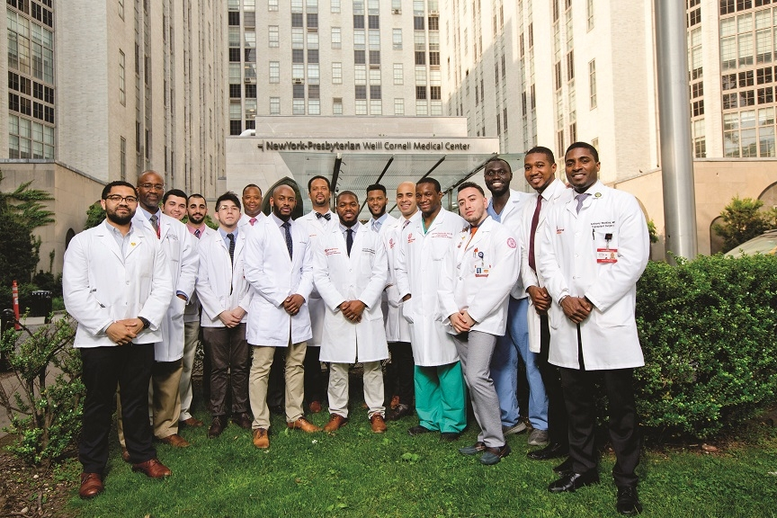 Hinson (seventh from left) outside NewYork-Presbyterian/Weill Cornell Medical Center with fellow members of the Black and Latino Men in Medicine Initiative, and (opposite page) on the WCM campus last summer