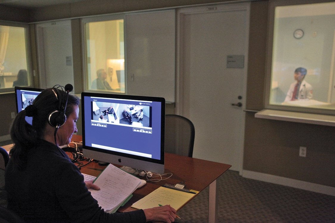 """Students in the Smith Clinical Skills Center, where future doctors are recorded on digital video while seeing """"patients"""" portrayed by actors"""