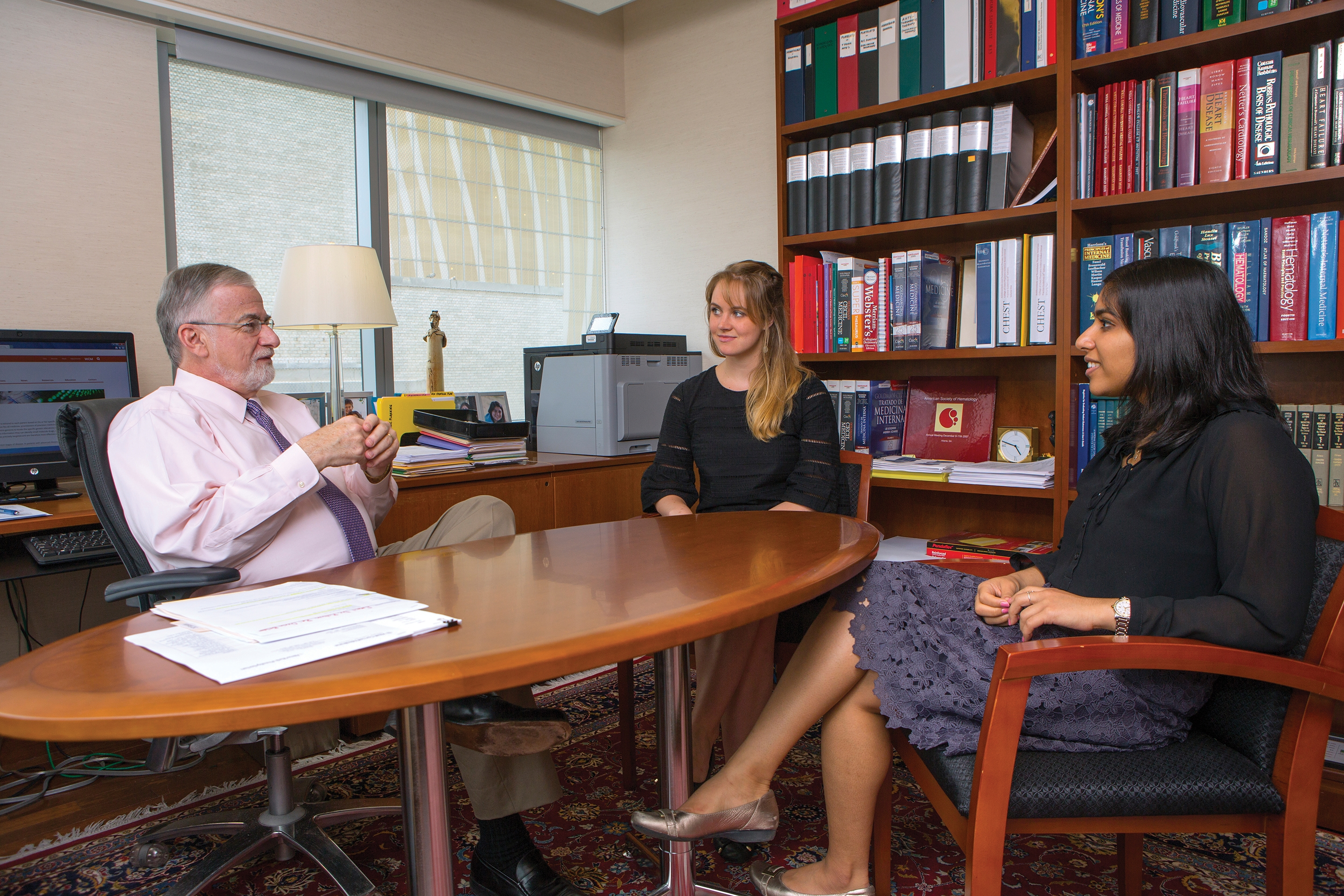 Dr. Andrew Schafer (left), with students Caitlin Gribbin '18 (center) and Aditi Gupta '18