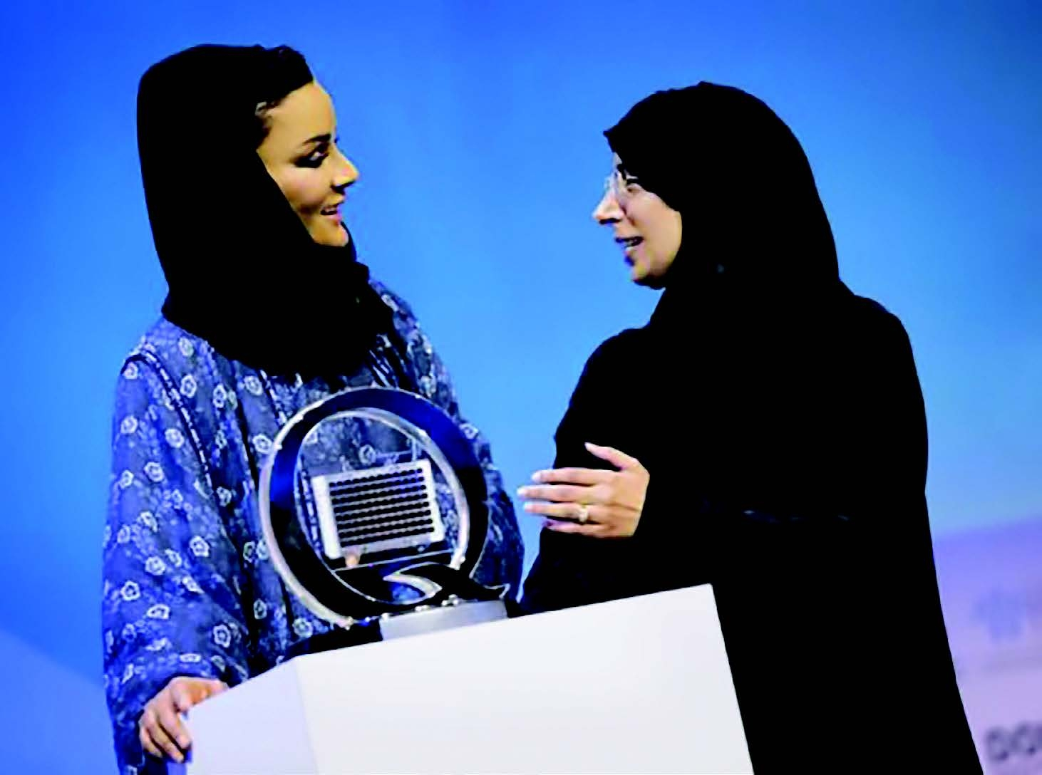 two women at a podium