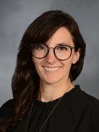 a woman smiling for a portrait