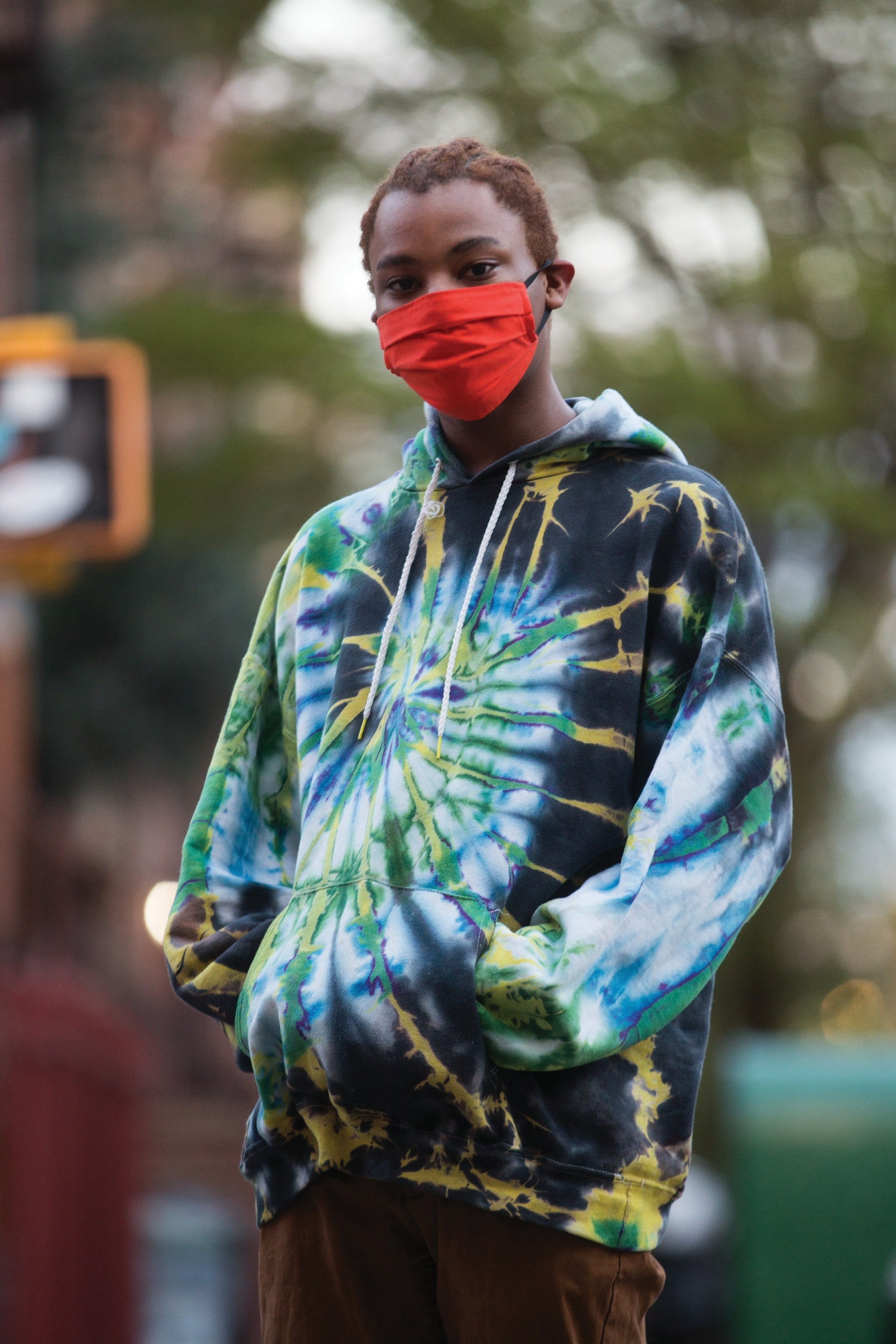 a boy wearing a red face mask