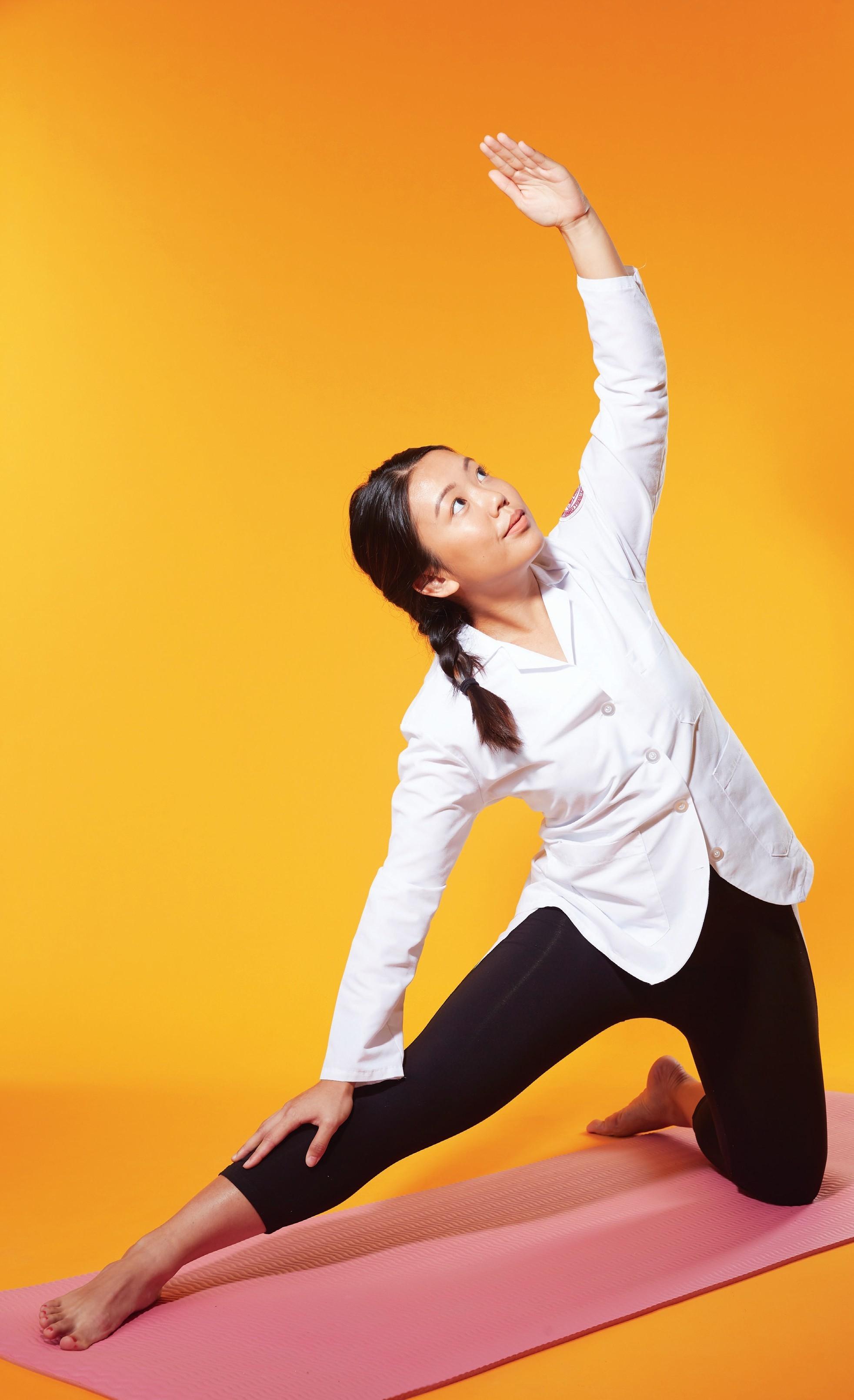 Student doing yoga.