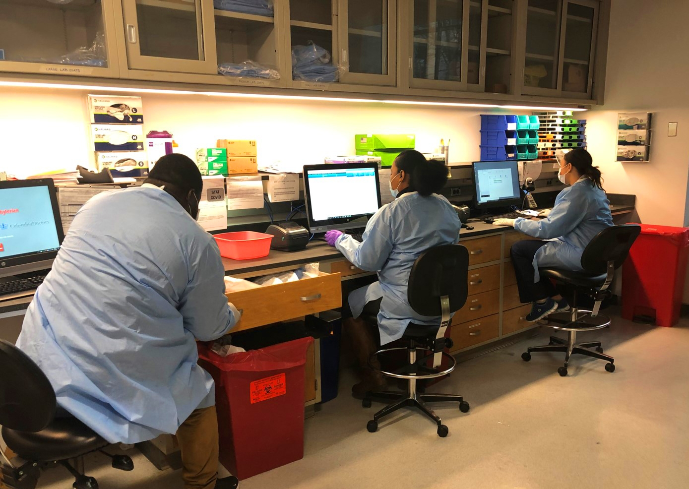 doctors working in a testing lab on computers