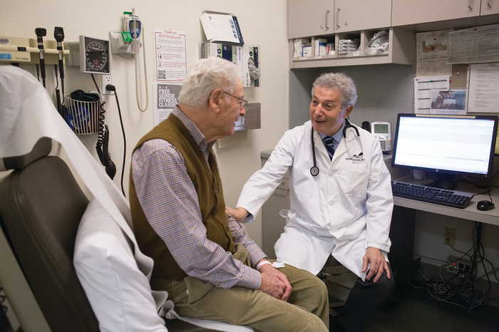 STAYING ACTIVE: Dr. Ronald Adelman (right), sees patient Gilbert Boas at the Irving Sherwood Wright Center on Aging.