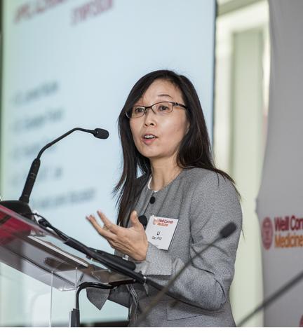 Dr. Li Gan at podium