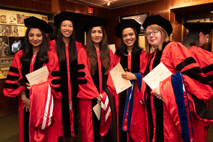 Graduates from Weill Cornell Graduate School of Medical Sciences' doctoral programs wait backstage before the Commencement ceremony on May 30. From left: Drs. Anam Ejaz, Maria Loressa Uson, Annum Munir, Radhika Agarwal and Darya Akimova.