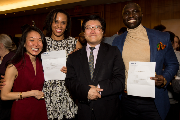 Ngozi Monu (second from left) and Joshua Adeji (right) celebrate their matches with Dr. Yoon Kang and Dr. Augustine M.K. Choi during Match Day on March 15, 2019. All photos: Ashley Jones. Click photo to view the full Match Day Flickr gallery.
