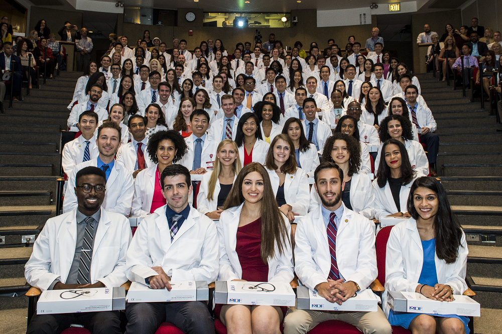 Weill Cornell Medical College's Class of 2022 during the White Coat Ceremony on Aug. 21. First row, from left: Oluwatobi Aladesuru, Daniel Alfonso, Stephanie Azzopardi, Evan Balmuth and Elora Basu. All photos: Ashley Jones. Click photo to view the full Ma