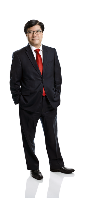 a man in a suit posing for a picture