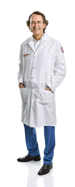 a man in a white coat posing