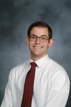 a man smiling for a portrait
