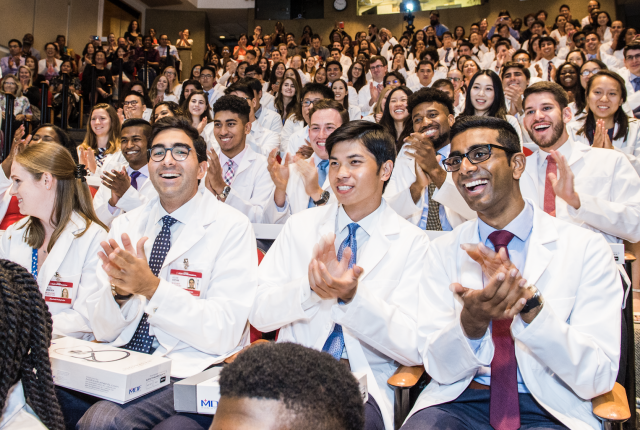 Students from the class of 2023 celebrate in Uris at the end of the White Coat ceremony.